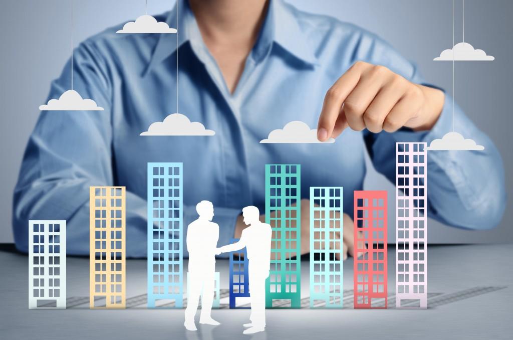 Building in hand businessmen